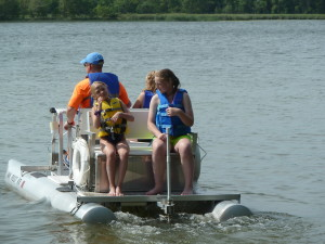 Seth taking the girls out on the pedal boat