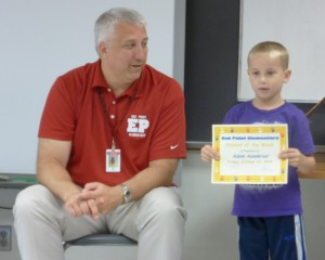 Adam receiving his 'Student of the Week' award from Principal Knorr!