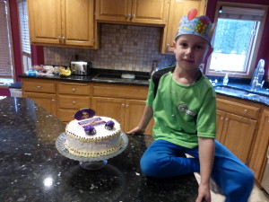 Adam with his crown from school and his surprise cake I made him!