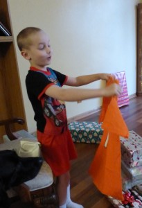 Adam was thrilled with his Peyton t-shirt! He threw his head back and laughed with excitement