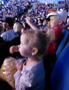 My view of the kids during most of the show: Allison eating popcorn, and Adam snapping pics!