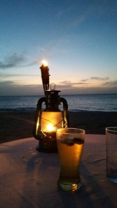 Drinks, lantern, tiki torch, and sunset.  Beautiful night at Bay Bistro