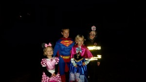 We met up with our neighbors while trick or treating! Kelsey as Anna and Colin as a fireman!