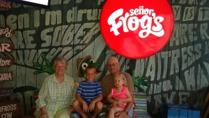 The kids with Grandma and Grandpa outside Senor Frog's
