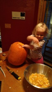 Allison loved digging the guts out of the pumpkins
