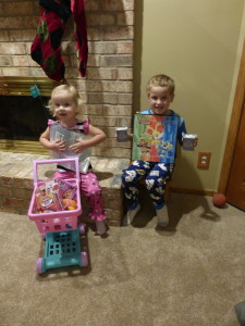 Santa came! They were so excited! Adam got Pokemon cards and Allison got a shopping cart