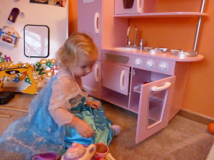 Allison (Elsa) playing with her new kitchen on Christmas morning